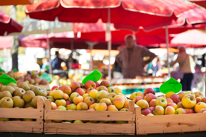 Baskets of apples at a farmers' market