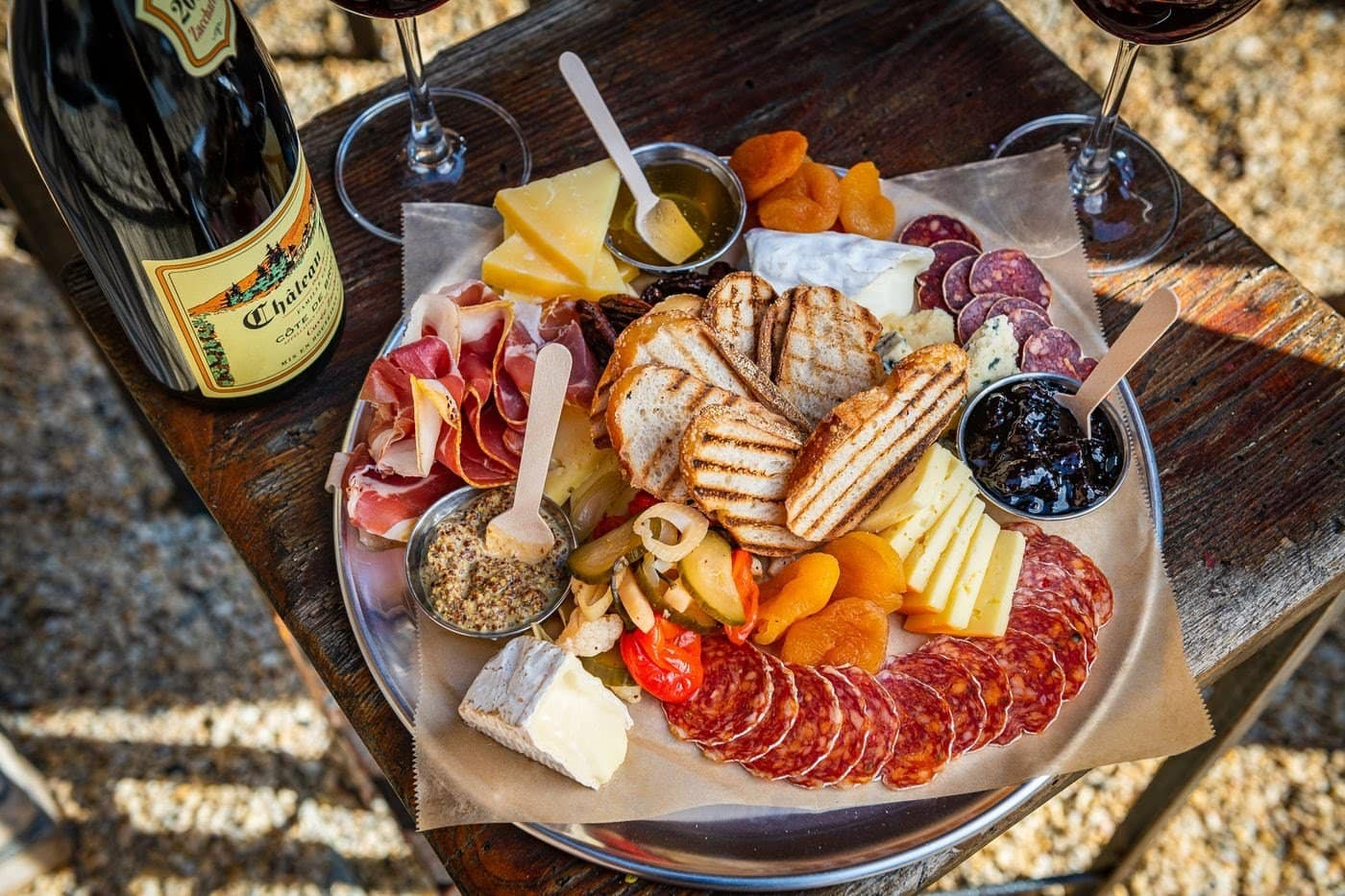 Charcuterie board with a bottle of wine